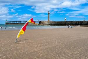 Swim flag on Whitby Beach